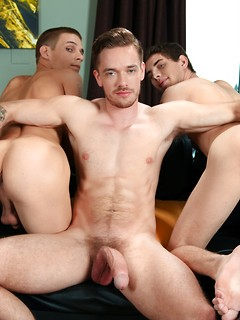 Three handsome young guys get around to pleasuring their pulsating meat poles